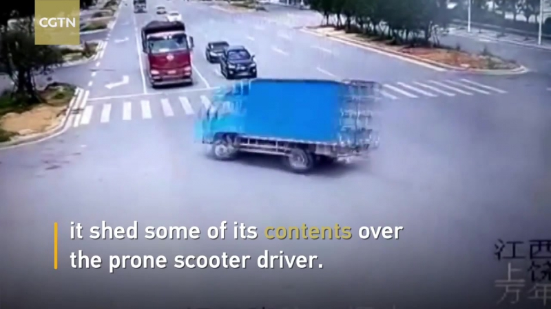 Scooter driver narrowly escapes death after running a red light