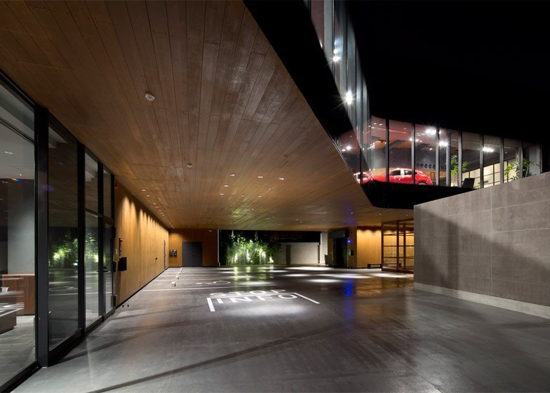 Mazda Showroom by Suppose Design Office pairs streamlined glazing with wood