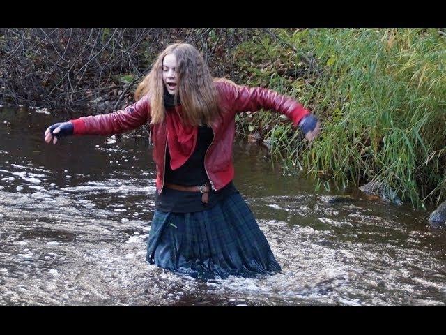 Girl dressed in kilt. Wet walk in hunters