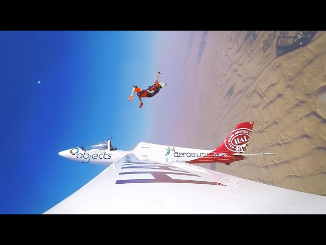 Skydiver Ejects From Glider
