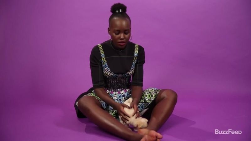 Black Panther39;s Lupita Nyong39;o Plays With Puppies (While Answering Fan Questions) - YouTube