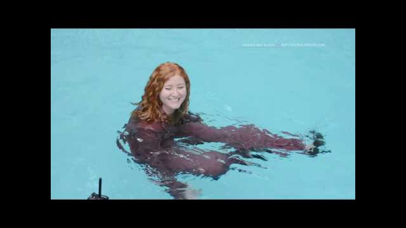 Savannah swims in a lavender business suit