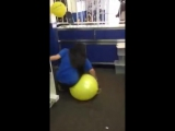 Girl sits on punchball