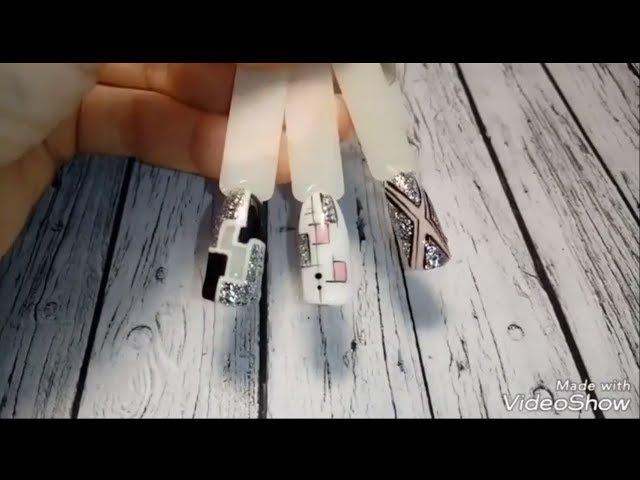 Модные дизайны ногтей с геометрией и серебряными хлопьями.