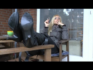 Blonde girl in boots smoking 2 at once