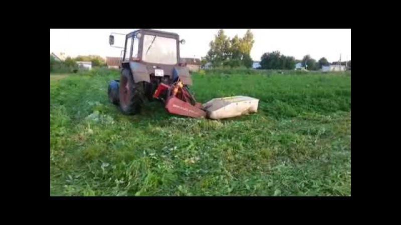 Скос лежачей травы навесной косилкой - Beveled grass