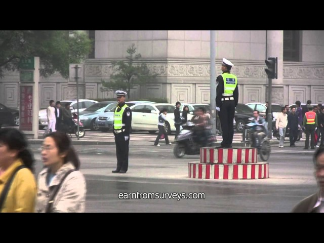 10 traffic policemen and traffic lights control an intersection in Xian(China)