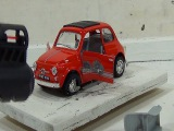Fiat 500. Shooting at Fiat 500 in slow motion. Toy car Fiat