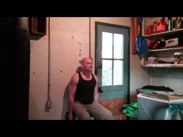 Isometric Samson Chair holding two 55 lb DB's (110 lbs total) for 90 seconds