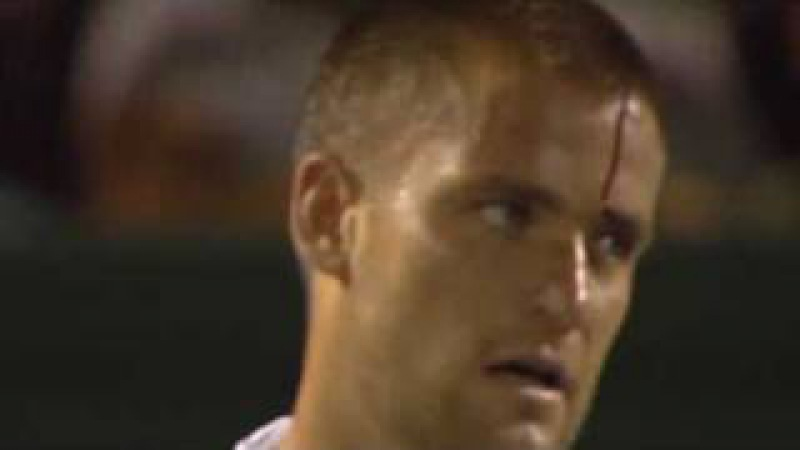 Youzhny reacts badly to losing point - hits his racquet against his head