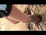 Girl stuck in quicksand/mud