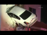 A speeding car was left dangling off the second floor of a building in Santa