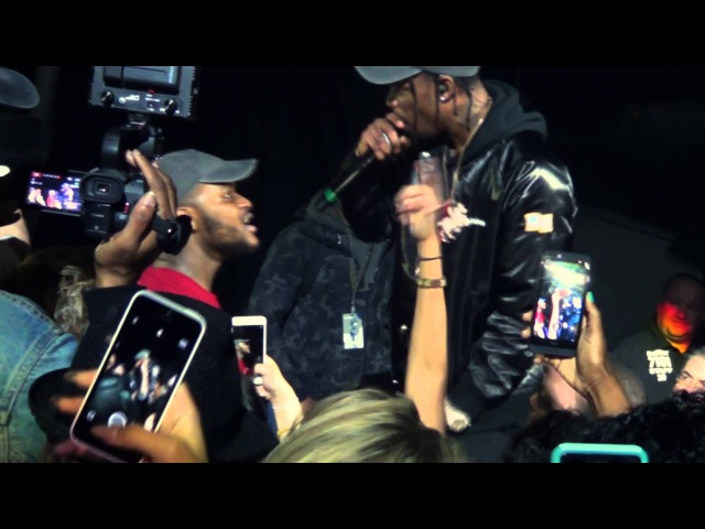 Drunk fan gets to keep Travis $cott's hat after finishing the song for him!