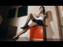 Sexy asian girl in school mini skirt and pantyhose