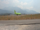 S7 Airlines Airbus A319 VP-BHJ taxing to back track.