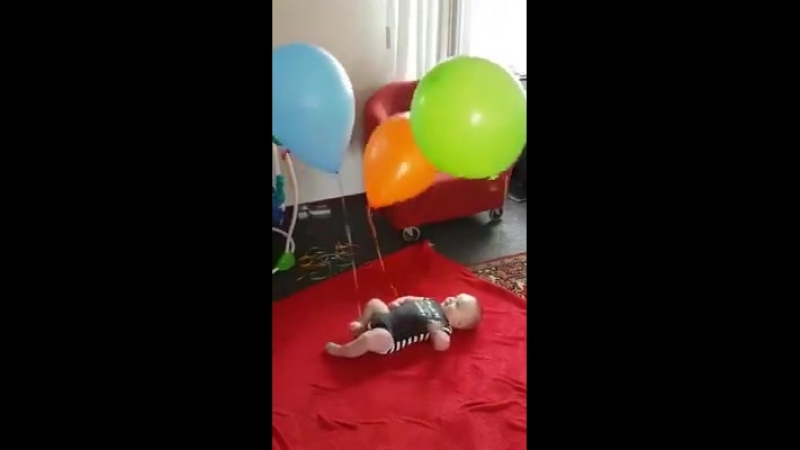 BABY IS PLAYING WITH BALOONS
