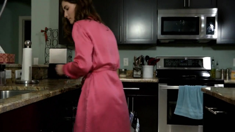 Girl in red satin robe, silk nightwear