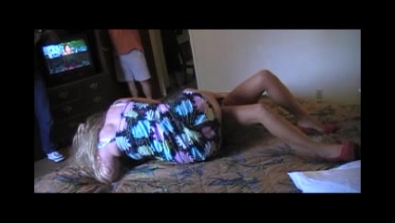 Husband watches, as his wife is forced into very papinful scissor holds.....