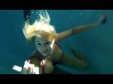 100 girls swimming underwater in pool