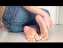 Teen boy feet in jeans