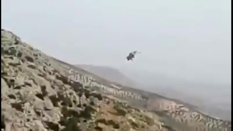 KURDS fighters down turkish helicopter