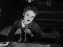 Чарли Чаплин - Танец с Булочками (к-ф Золотая Лихорадка)