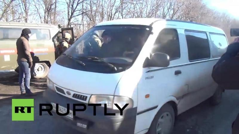 [Ruptly] Ukraine See war-shattered Kiev soldier COLLAPSE off moving Debaltsevo IFV