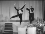 A clip from the movie Stormy Weather (1943) featuring Cab Calloway and his orchestra performing Jumpin Jive with the Nicholas Br