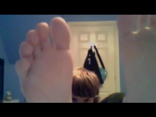 Young brown haired boy shows his feet...