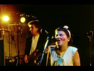 A rosy-cheeked björk with her first band, tappi tíkarrass, circa 1982.