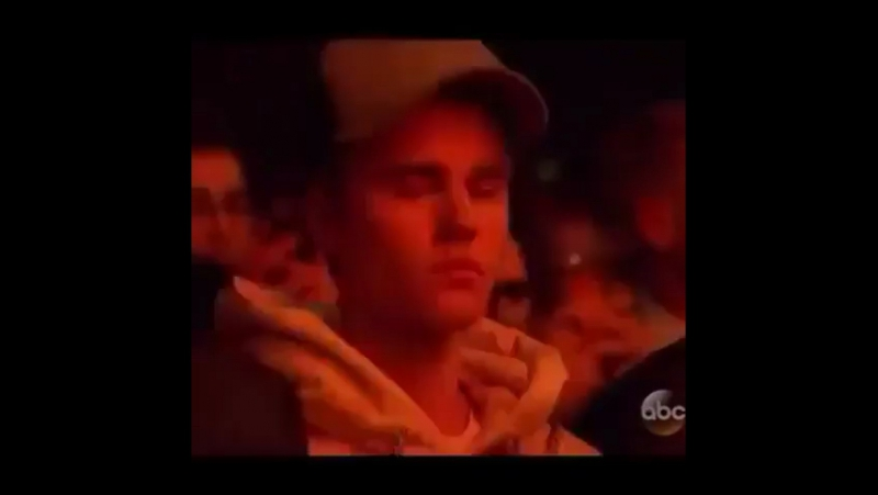 Justin Bieber during The Weeknd's performance of «The Hills» at American Music Awards 2015