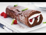 Mary Berry's gorgeous chocolate roulade is made without flour so it's light as a feather.