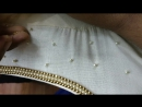 Finishing Pearl Work on a Salwar