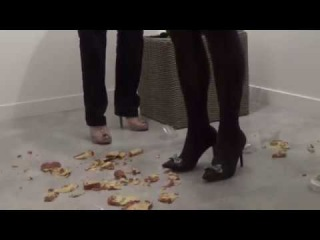 CRUSHING HEELS - Crush plastic cups and a cake in stiletto heels.
