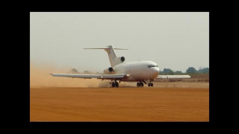 Mighty Boeing 727 landing on dirt airstrip.