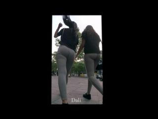 two arabic sisters in skintight grey leggings