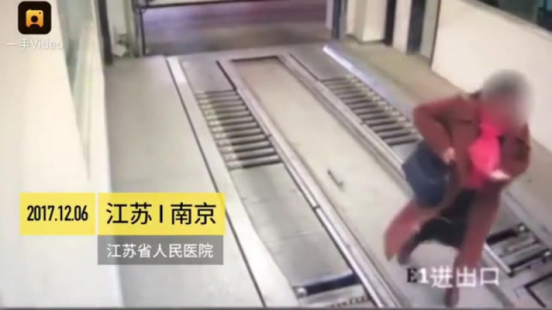 Not very smart woman hanging on a phone gets run over in elevator garage.