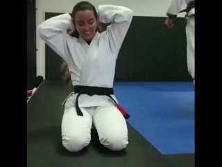 Angelica Galvao. Belt and hair.