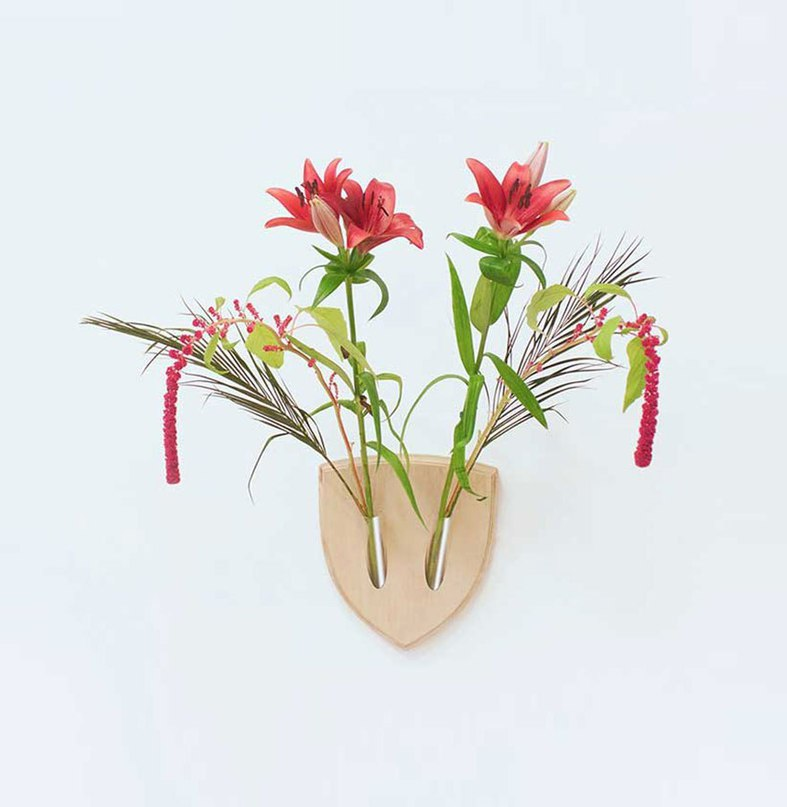 "Ikebana (生け花), also referred to as ""living flowers"", is an ancient Japanese art of harmonious flower arrangement."
