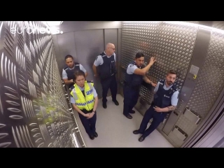 Nz_police_prove_theyre_not_your_typical_beat_cops_with_elevator_jam_session[1]