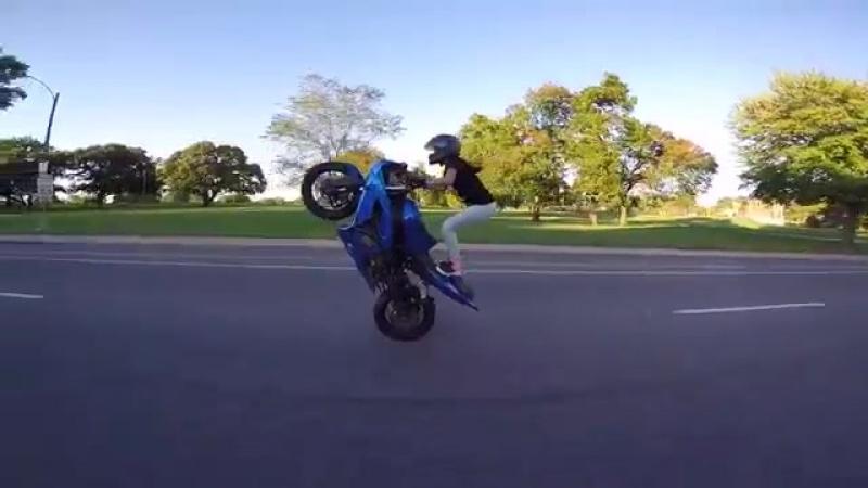 GIRL rides crazy WHEELIE in traffic 2016 INSANE extreme motorcycle stunts