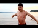 Young muscle kid crushing melons, flexing and wrestling with brother
