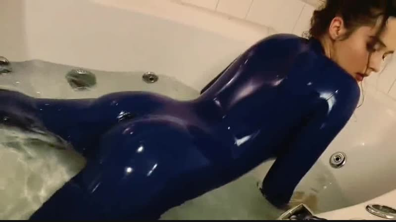 In blue Latex Catsuit to Bathtub