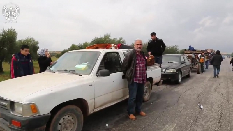 Kurdish civilians returning back to the liberated areas in Afrin are welcomed by a Kurdish commander of the National Army FSA.