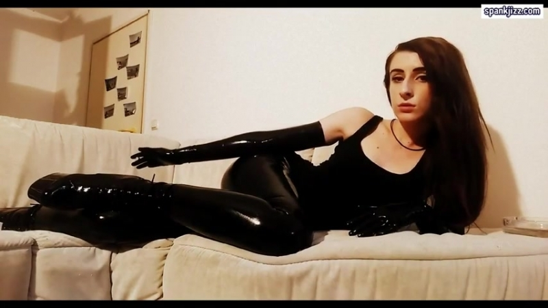 Lady smoking in latex dress and gloves