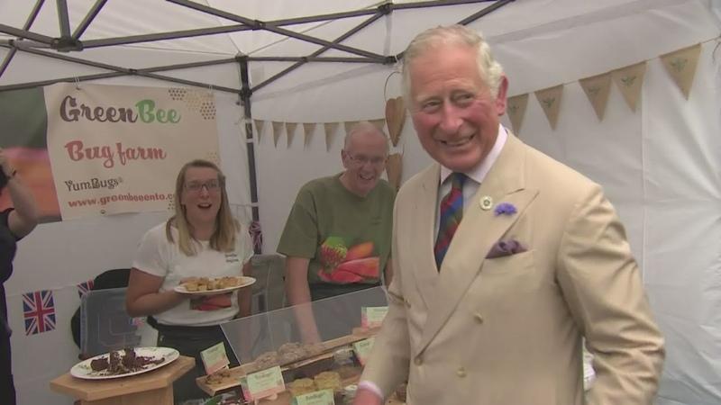 Prince Charles and Camilla enjoy local produce at Honiton market