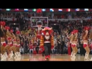 Benny The Bull makes a one-handed backwards shot from half-court
