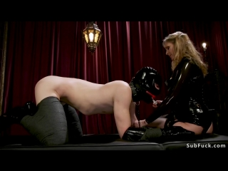 Latex mistress makes sub suck strap on cock