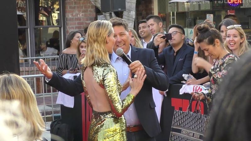 Leslie Bibb and Sam Rockwell outside the TAG Premiere at Regency Village Theatre in Westwood