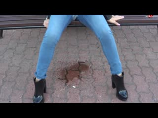 Jeans piss on bench in public